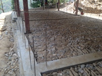Building Two, with both foundation pours complete, stone sub-grade for the classroom flooring complete, and all ready for bricks!